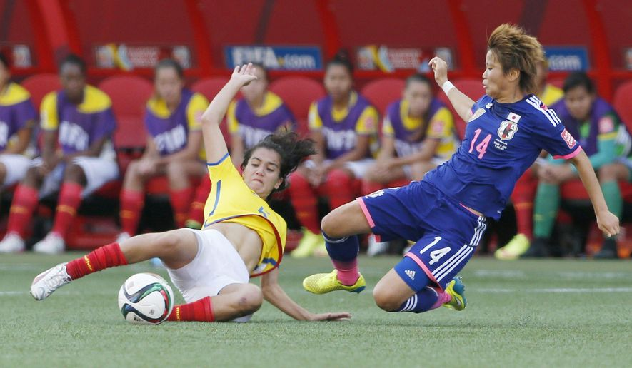 Ecuador's Mayra Olivera (5) and Japan's Asuna Tanaka (14) vie for the ball during the first half of a FIFA Women's World Cup soccer game in Winnipeg, Manitoba, Canada, on Tuesday, June 16, 2015. (John Woods/The Canadian Press via AP)