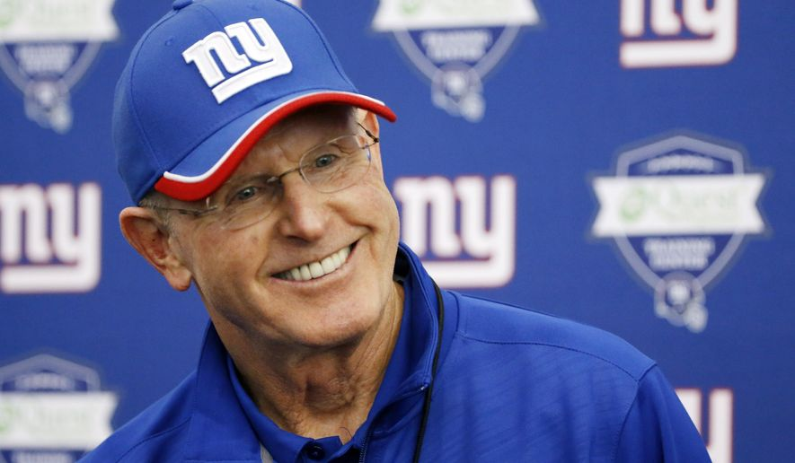 New York Giants head coach Tom Coughlin talks to reporters during an NFL football mini camp, Tuesday, June 16, 2015, in East Rutherford, N.J. (AP Photo/Julio Cortez)