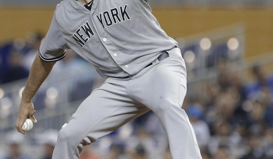 New York Yankees' Nathan Eovaldi winds up during the first inning of a baseball game against the Miami Marlins, Tuesday, June 16, 2015, in Miami. (AP Photo/Wilfredo Lee)