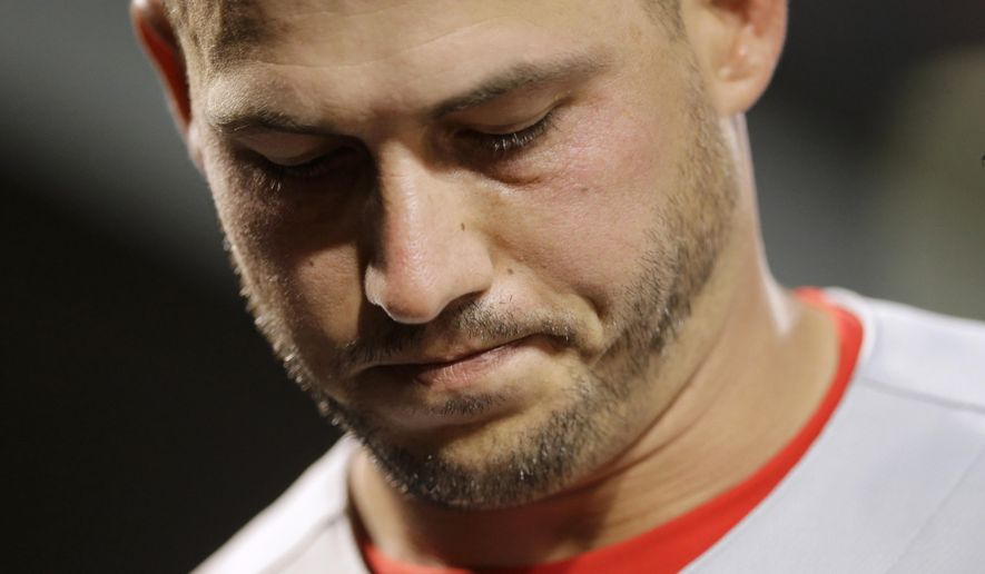Philadelphia Phillies relief pitcher Dustin McGowan walks into the clubhouse in the fifth inning of an interleague baseball game against the Baltimore Orioles, Tuesday, June 16, 2015, in Baltimore. Baltimore scored six runs against McGowan, and Baltimore won 19-3. (AP Photo/Patrick Semansky)