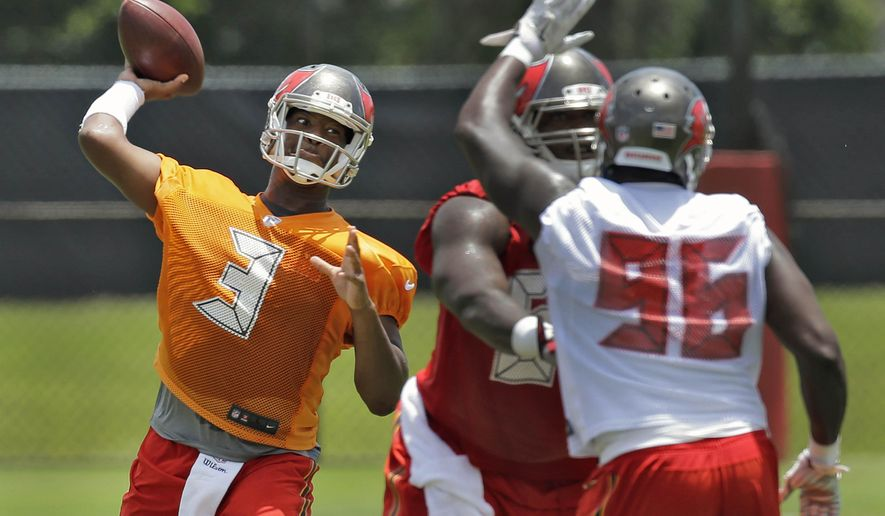 Tampa Bay Buccaneers quarterback Jameis Winston (3) throws a pass as he is pressured by defensive end T.J. Fatinikun (96) during a Buccaneers NFL football mini camp Tuesday, June 16, 2015, in Tampa, Fla. (AP Photo/Chris O'Meara)