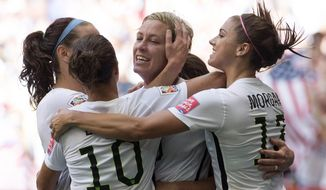 United States' Abby Wambach celebrates her goal with her teammates during the first half of a FIFA Women's World Cup soccer match against Nigeria, Tuesday, June 16, 2015 in Vancouver, New Brunswick, Canada (Jonathan Hayward/The Canadian Press via AP) MANDATORY CREDIT
