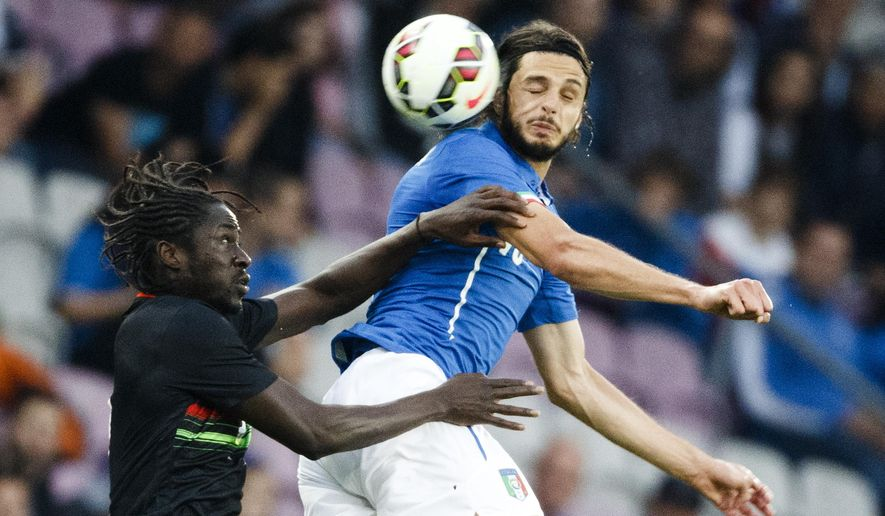 Portugal's Ederzito Lopes, left, fights for the ball against Italy's Andrea Ranocchia during their international friendly soccer match at the Stade de Geneve in Geneva, Switzerland, Tuesday, June 16, 2015. (Valentin Flauraud/Keystone via AP)