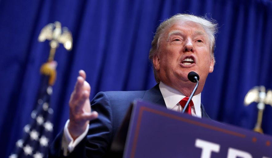 Developer Donald Trump gestures as he announces that he is seeking the Republican nomination for president, Tuesday, June 16, 2015, in the lobby of Trump Tower in New York. (AP Photo/Richard Drew)
