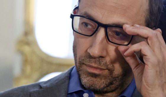 FILE - In this March 5, 2015 file photo, then Twitter CEO Dick Costolo, adjusts his glasses as he listens to the speech of France's Culture Minister, Fleur Pellerin, at a news conference on Museum Week at France's Culture Ministry in Paris. Costolo, who is ending his nearly five-year reign as CEO on July 1, on Tuesday, June 16, 2015 told a technology conference he is leaving the company with a line-up of upcoming features designed to make the short-messaging service more profitable and more useful to more people. (AP Photo/Michel Euler, File)