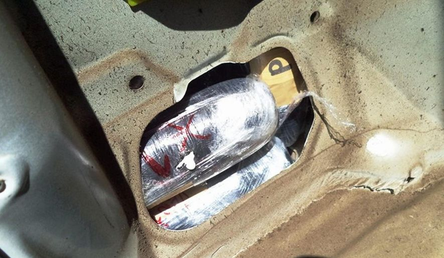 This Wednesday, June 10, 2015 photo provided by U.S. Customs and Border Protection, packages of hard drugs are seen in the rear driver side quarter panel of a car carrying more than $377,000 worth of heroin and methamphetamine, seized at the U.S.-Mexico border port of entry in Nogales, Ariz.  Authorities are reporting an alarming increase in the number of methamphetamine seizures at border ports of entry.  (U.S. Customs and Border Protection via AP)