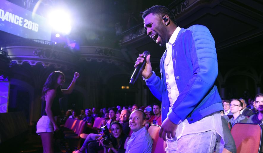 "Singer Jason Derulo performs during the ""Just Dance 2016"" game segment at Ubisoft's E3 2015 Conference at the Orpheum Theatre on Monday, June 15, 2015, in Los Angeles. (Photo by Chris Pizzello/Invision/AP)"