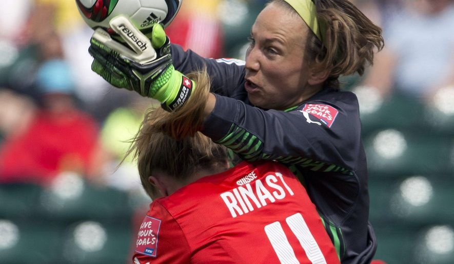 Switzerland goalie Gaelle Thalmann makes the save as Cameroon's Yvonne Leuko (4) challenges for the ball during the first half of a FIFA Women's World Cup soccer match, Tuesday, June 16, 2015 in Edmonton, Alberta, Canada. (Jason Franson/The Canadian Press via AP) MANDATORY CREDIT