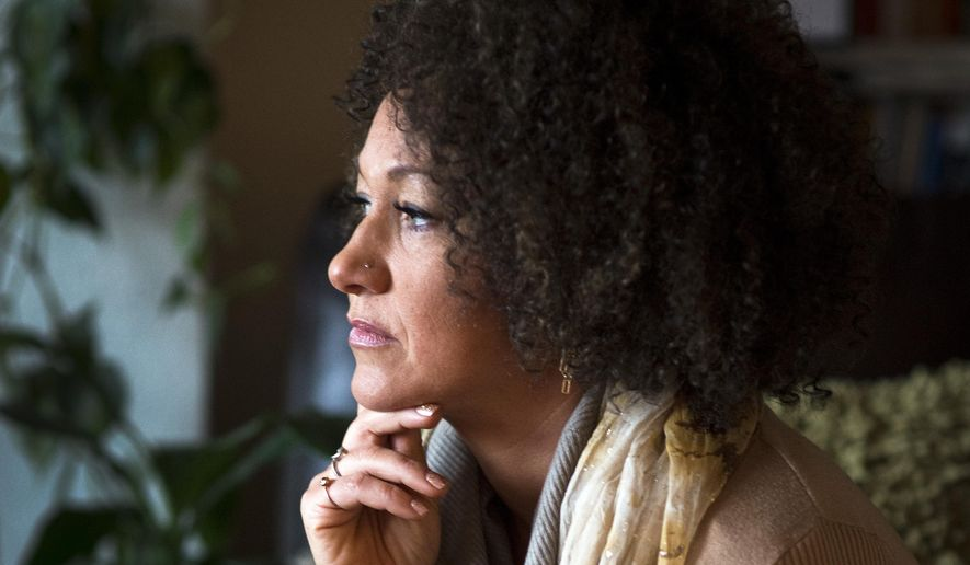 In this March 2, 2015, file photo, Rachel Dolezal, president of the Spokane chapter of the NAACP, poses for a photo in her Spokane, Wash., home. (Colin Mulvany/The Spokesman-Review via AP, File)