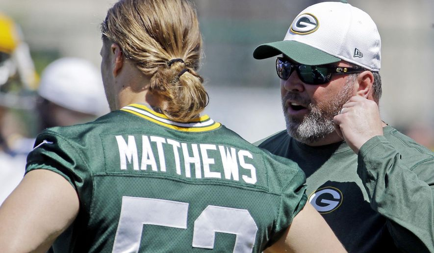 Green Bay Packers head coach Mike McCarthy, right, talks to Clay Matthews during NFL football minicamp, Tuesday, June 16, 2015, in Green Bay, Wis. (AP Photo/Morry Gash)