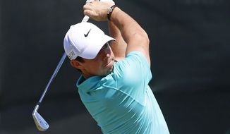 Rory McIlroy, of Northern Ireland, warms up on the range before a practice round for the U.S. Open golf tournament at Chambers Bay on Tuesday, June 16, 2015 in University Place, Wash. (AP Photo/Lenny Ignelzi)