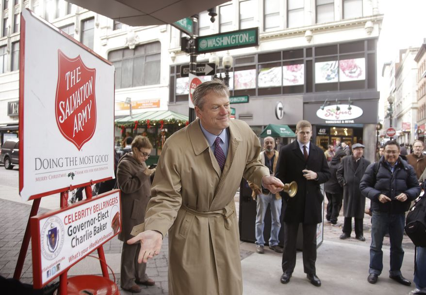 Incoming Massachusetts Gov. Charlie Baker invites donations as a Salvation Army holiday bell ringer Thursday, Dec. 18, 2014 in the Downtown Crossing area of Boston. (AP Photo/Stephan Savoia)
