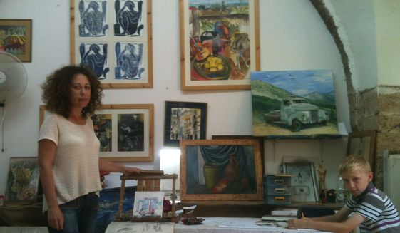 Ella Rozenberg with one of her art students at her studio in the Gaza border town of Ashkelon, Israel. The studio is located inside a stone stable built inside the ancient walls of a old hotel dating back to the crusades. (Photo by L. Todd Wood)