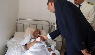 Tunisia's Prime Minister Habib Essid, center, conforts a passenger injured in a train crash at Zaghwan hospital, northern Tunisia, Tuesday, June 16, 2015. (AP Photo/Habib Aissa) ** FILE **