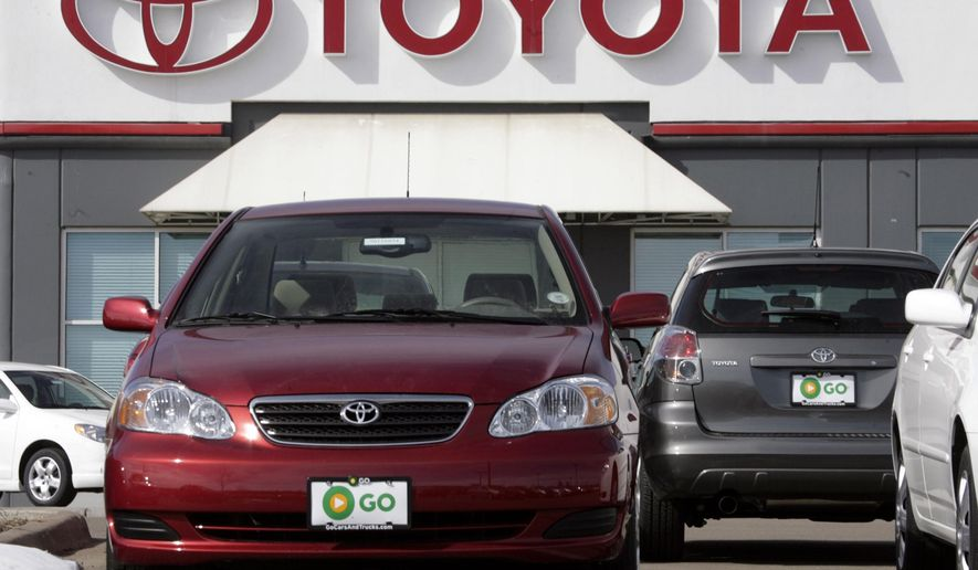 FILE - In this Feb. 5, 2007 file photo, a 2007 Toyota Corolla sedan and Matrix wagons sit on the lot at a Toyota dealership in the southeast Denver suburb of Centennial, Colo. Toyota on Tuesday, June 16, 2015 added nearly 1.4 million cars, trucks and SUVs, including the 2003 to 2007 Corolla and Matrix, to a growing recall for air bags that can explode with too much force. (AP Photo/David Zalubowski, File)