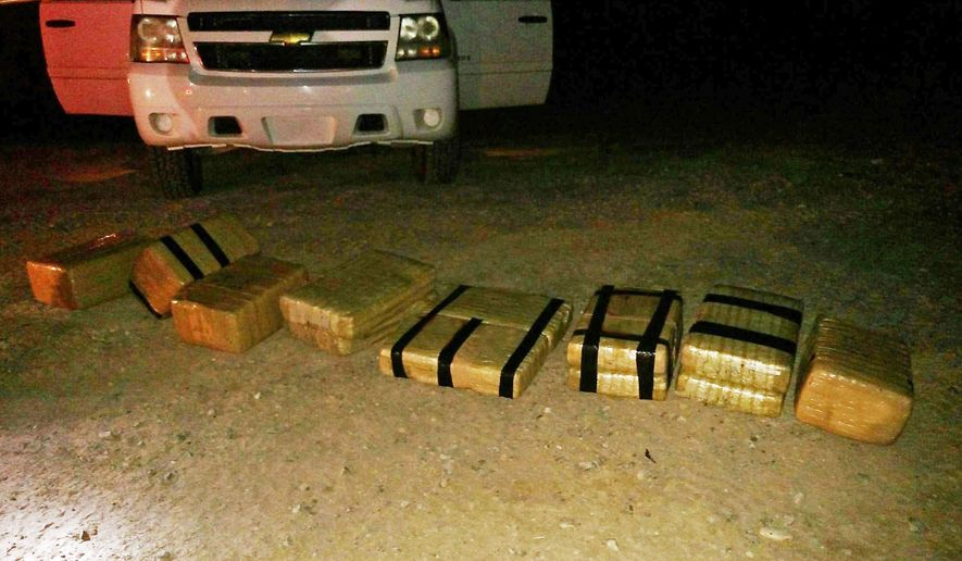 This undated photo provided by  the U.S. Customs and Border Protection shows some 180 pounds of marijuana that was brought into the U.S. from Mexico aboard a go-cart, seen near Yuma, Ariz. The go-cart crossed into the United States and fled back to Mexico after unloading $90,000 worth of drugs. The incident occurred Thursday night, June 11, 2015 near Yuma and led to a Border Patrol pursuit of the smugglers.  (U.S. Customs and Border Protection via AP)