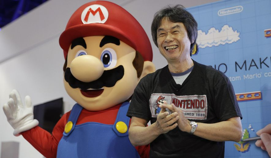 In this June 11, 2014 file photo, Japanese video game designer Shigeru Miyamoto introduces the Nintendo's Mario Maker during a press event at the Nintendo booth at the Electronic Entertainment Expo, in Los Angeles. (AP Photo/Jae C. Hong, File)