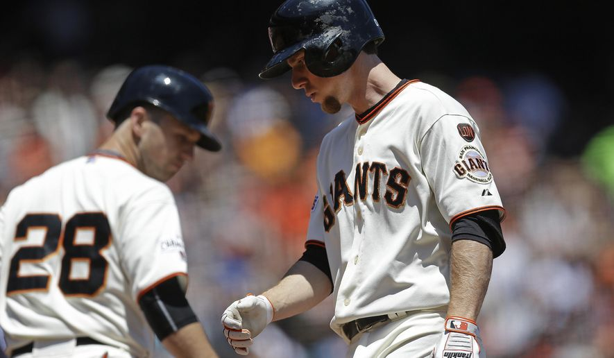San Francisco Giants' Matt Duffy, right, is congratulated by Buster Posey (28) after Duffy hit a two run home run off Seattle Mariners' J.A. Happ in the second inning of a baseball game Tuesday, June 16, 2015, in San Francisco. (AP Photo/Ben Margot)