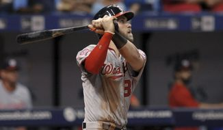 Washington Nationals' Bryce Harper watches his solo home run to right center off Tampa Bay Rays reliever C.J. Riefenhauser during the fifth inning of a baseball game Tuesday, June 16, 2015, in St. Petersburg, Fla. (AP Photo/Steve Nesius)