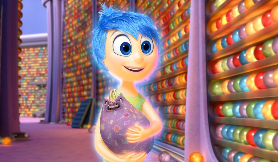 """In this image released by Disney-Pixar, the character Joy, voiced by Amy Poehler, appears in a scene from """"Inside Out,"""" in theaters on June 19. (Disney-Pixar via AP)"""