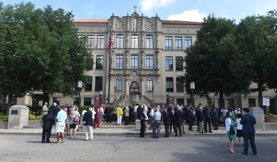 A large crowd gathers at The University of Detroit Jesuit High School and Academy as a STEM curriculum is dedicated on Tuesday, June 16, 2015.  The school raised $16 million for the science, technology, engineering and math building.  The school raised $16 million for the science, technology, engineering and math building. Construction has begun on the Science and Engineering Center at the University of Detroit Jesuit High School and Academy.  (Max Ortiz/The Detroit News via AP)