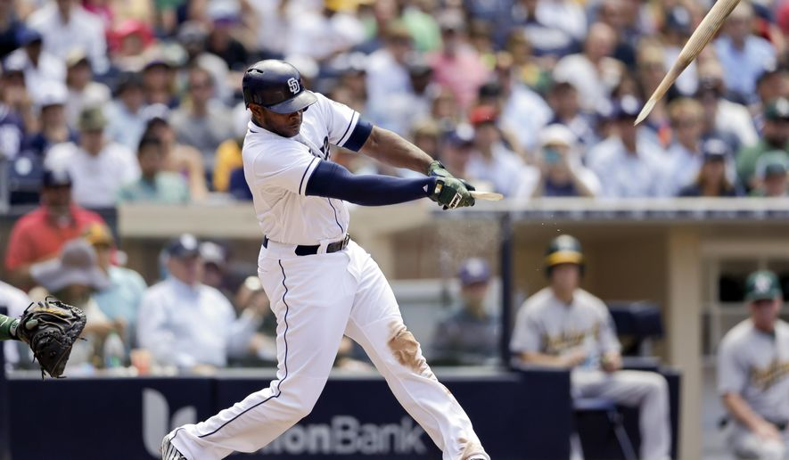 San Diego Padres' Justin Upton breaks his bat as he grounds into a double play during the eighth inning of a baseball game against the Oakland Athletics on Tuesday, June 16, 2015, in San Diego. Melvin Upton Jr. scored, and Yonder Alonso was out at second on the play. (AP Photo/Gregory Bull)