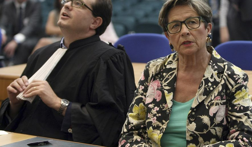 FILE - In this June 5, 2015 file photo, Viviane Lambert, mother of Vincent Lambert, a Frenchman who has been comatose for seven years, attends with her lawyer Jerome Triomphe a verdict about her son in the European Court of Human Rights in Strasbourg, eastern France. France's debate over end-of-life care goes to the Senate, with a bill that would allow doctors to keep terminally ill patients sedated until death comes, but stops short of legalizing euthanasia and assisted suicide. (AP Photo/Christian Lutz, File)