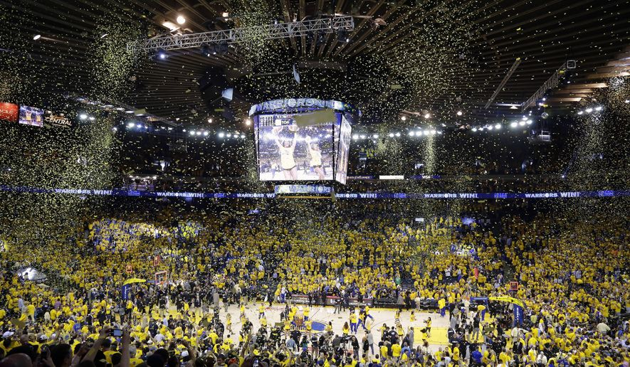Confetti falls at Oracle Arena after Game 5 of basketball's NBA Finals between the Golden State Warriors and the Cleveland Cavaliers in Oakland, Calif., Sunday, June 14, 2015. The Warriors won 104-91. (AP Photo/Eric Risberg)