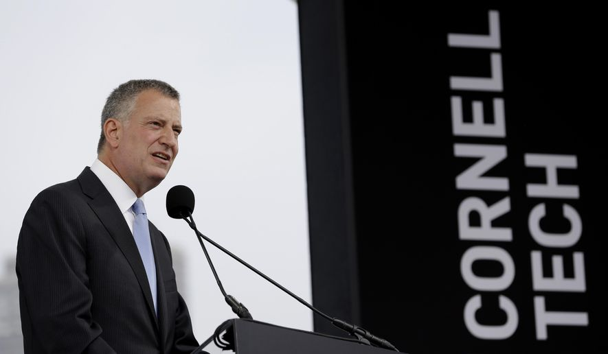 New York City Mayor Bill de Blasio speaks during a ground breaking ceremony for Cornell Tech on Roosevelt Island in New York, Tuesday, June 16, 2015. Former New York City Mayor Michael Bloomberg's charity foundation, Bloomberg Philanthropies, is donating $100 million to Cornell University for the new high-tech graduate school campus. (AP Photo/Seth Wenig)