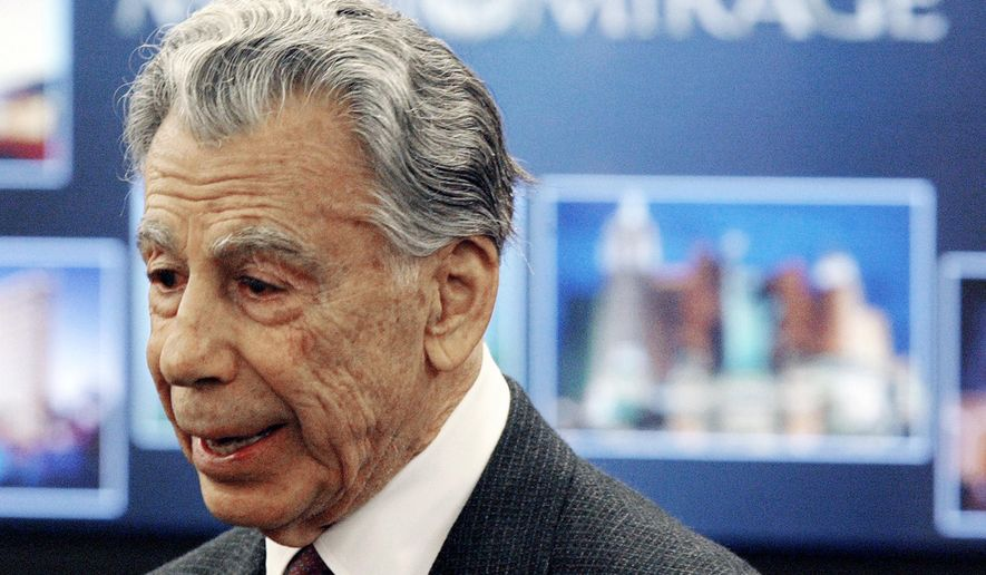 FILE - In this Feb. 22, 2005 file photo, Kirk Kerkorian, majority shareholder of MGM Mirage, speaks to the media at the Nevada Gaming Control Board hearing in Las Vegas. Kerkorian, an eighth-grade dropout who built Las Vegas' biggest hotels, tried to take over Chrysler and bought and sold MGM at a profit three times, died Monday, June 15, 2015. He was 98. (AP Photo/Joe Cavaretta,File)