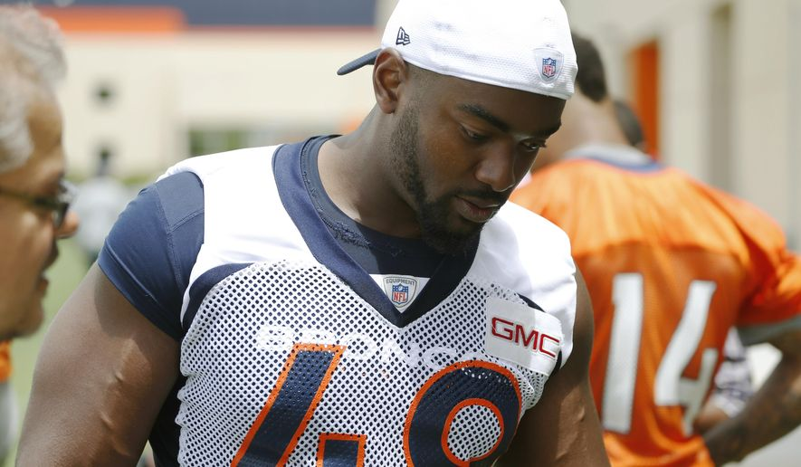 In this photograph taken Thursday, June 11, 2015, Denver Broncos linebacker Chase Vaughn leaves the field after taking part in NFL football minicamp in Englewood, Colo. Vaughn is trying to earn a spot at outside linebacker during the Broncos' organized training activities. (AP Photo/David Zalubowski)