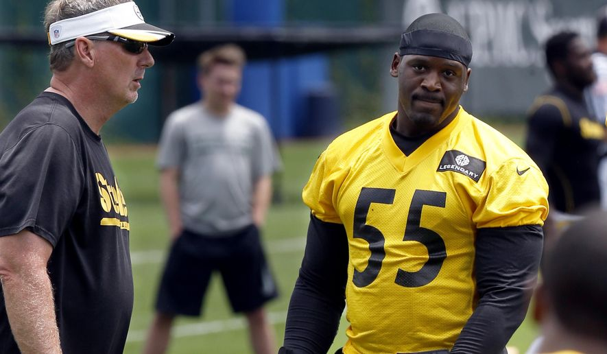 Pittsburgh Steelers outside linebacker Arthur Moats (55) stands with defensive coordinator Keith Butler at the start of drills in the NFL football mini camp, Tuesday, June 16, 2015 in Pittsburgh. Moats says he is ready to build on his promising 2014 season. His versatility helped him land a three-year extension during the offseason. (AP Photo/Keith Srakocic)
