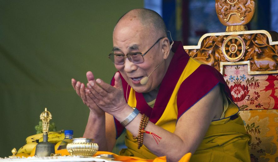 The Dalai Lama, Tibetan spiritual leader, gestures as he talks during a special ritual ceremony at the Tibetan Children's Village School in Dharmsala, India, in this Friday, May 29, 2015, file photo. The National Constitution Center CEO Jeffrey Rosen announced Wednesday, June 17, 2015 that the Dalai Lama will be honored with Philadelphia's Liberty Medal for his efforts to promote compassion and human rights around the globe. (AP Photo/Ashwini Bhatia, File)