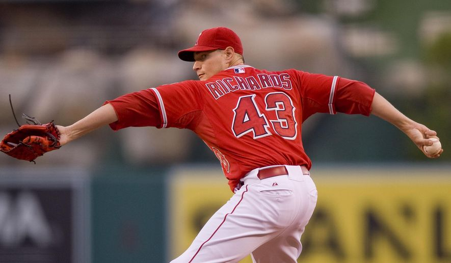 Angels starting pitcher Garrett Richards delivers a pitch against the Arizona Diamondbacks in the second inning of a baseball game against the Arizona Diamondbacks in Anaheim, Calif., Tuesday, June 16, 2015. (Paul Rodriguez/The Orange County Register via AP)   MAGS OUT; LOS ANGELES TIMES OUT; MANDATORY CREDIT