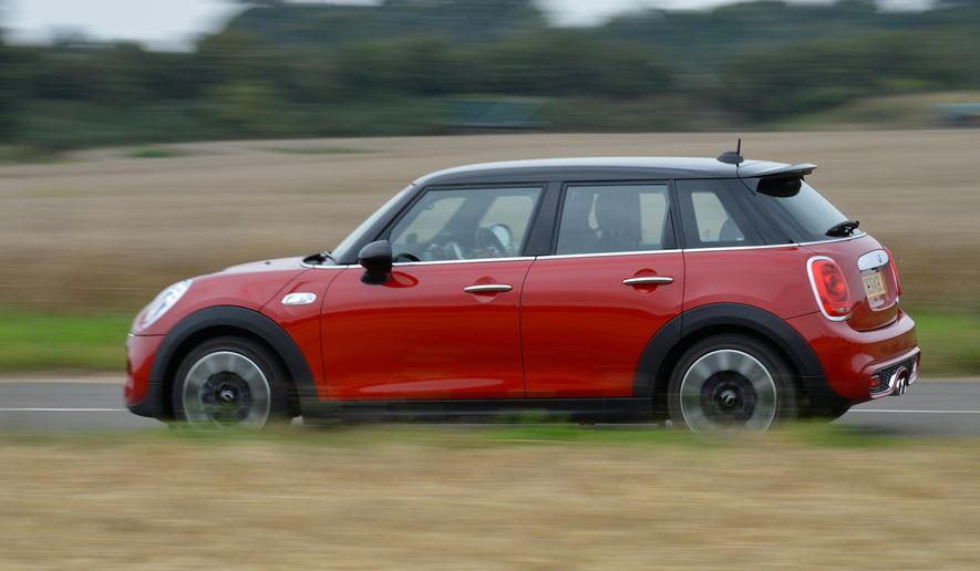 This undated photo made available by MINI USA shows a 2015 Mini Cooper S Hardtop 4 Door. (MINI USA via AP)