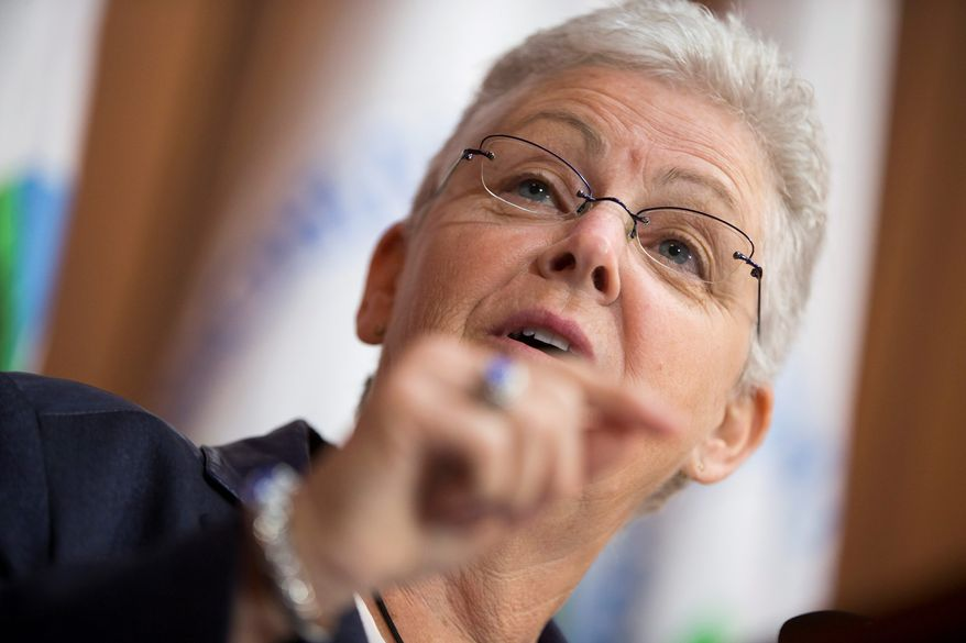 Environmental Protection Agency Administrator Gina McCarthy, disputing energy industry estimates, argues that average Americans ultimately will see lower electric bills as a result of regulations under President Obama's climate change agenda. (Associated Press)