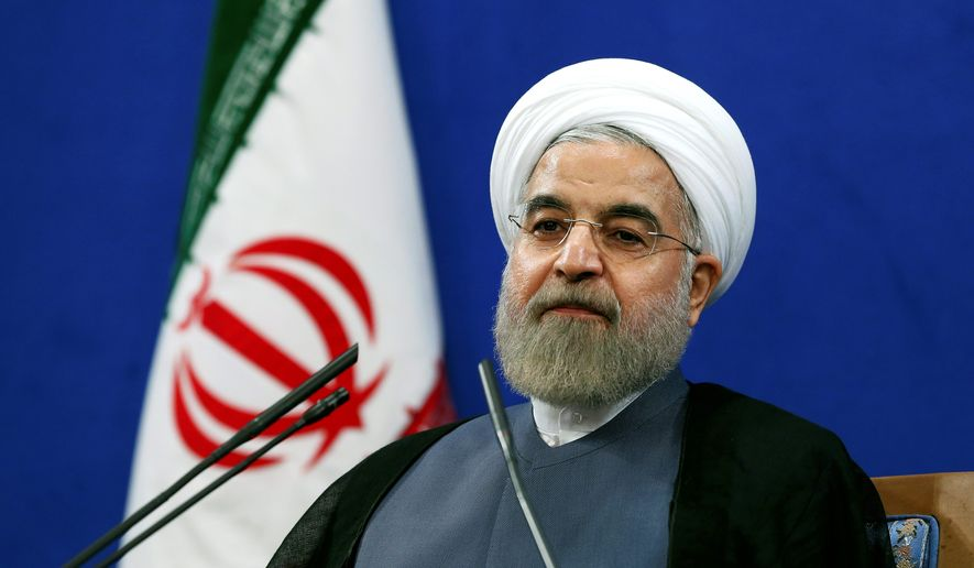 Iranian President Hassan Rouhani gives a press conference on the second anniversary of his election in Tehran on June 13, 2015. (Associated Press) **FILE**
