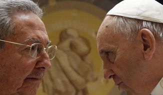In this file photo released on Monday, May 11, 2015, Pope Francis meets Cuban President Raul Castro during a private audience at the Vatican, Sunday, May 10, 2015. Cuban President Raul Castro has been welcomed at the Vatican by Pope Francis, who played a key role in the breakthrough between Washington and Havana aimed at restoring U.S.-Cuban diplomatic ties. (Gregorio Borgia, File Pool Photo via AP)