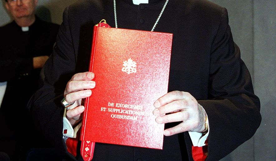 "In this Tuesday Jan. 26, 1999 file picture, Cardinal Jorge Medina Estevez of Chile, holds the book ""De Exorcismis et Supplicationibus Quibusdam"" (Of Exorcisms and Supplications), the Vatican's new guidelines on exorcism, presented during a news conference at the Vatican. The 1999 guidelines, written in Latin, update the last set written in 1614. After four centuries, The Vatican's guidelines for driving out the devil includes a caveat not to mistake psychiatric illness for diabolic possession. America's Roman Catholic bishops say there's a shortage of exorcists in the country. To fix the problem, they're holding a conference Friday, Nov. 12, 2010 and Saturday in Baltimore on how to perform the rite. (AP Photo/Marco Ravagli)"