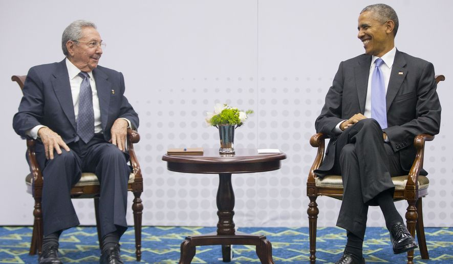 FILE - In this April 11, 2015, file photo, US President Barack Obama, right, smiles as he looks over towards Cuban President Raul Castro, left, during their meeting at the Summit of the Americas in Panama City, Panama. On Decmeber 17, 2014, Presidents Barack Obama and Raul Castro stunned the world by announcing an end to their nations' half-century of official hostility. (AP Photo/Pablo Martinez Monsivais, File)