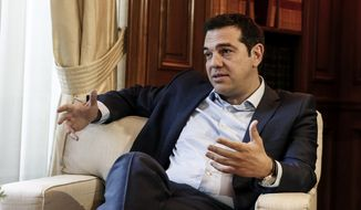 Greece's Prime Minister Alexis Tsipras speaks with visiting Austrian Chancellor Werner Faymann in Athens, Greece, on Wednesday, June 17, 2015. (AP Photo/Yorgos Karahalis) ** FILE **