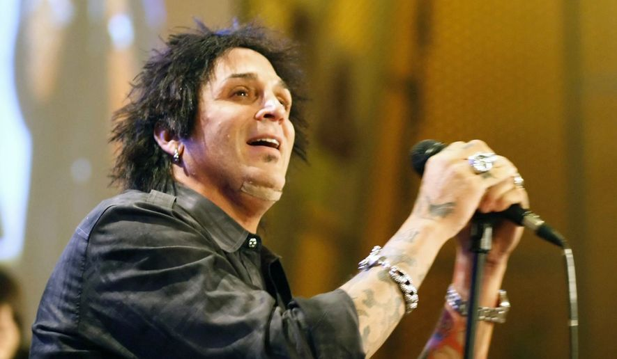 Deen Castronovo, drummer for rock band Journey, performs at the Salem Conference Center in Salem, Ore., in this Thursday, April 28, 2011, file photo. Castronovo has been released on bail following a domestic violence arrest in Oregon. (AP Photo/Statesman-Journal, Timothy J. Gonzalez, file)