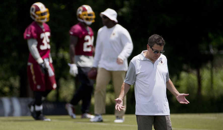 Washington Redskins owner Daniel Snyder, center, on the sidelines as players participate in drills during NFL football minicamp at Redskins Park Tuesday, June 16, 2015 in Ashburn, Va. (AP Photo/Pablo Martinez Monsivais)