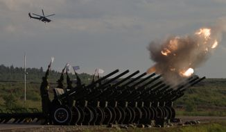 Russian Army's MI-28 attack helicopter flies as salute cannons fire during a show at a shooting range in Alabino, outside of Moscow, Russia, on Tuesday, June 16, 2015. Russia's military this year alone will receive over 40 new intercontinental ballistic missiles capable of piercing any missile defences, President Vladimir Putin said Tuesday in a blunt reminder of the nation's nuclear might amid tensions with the West over Ukraine. (AP Photo/Ivan Sekretarev)