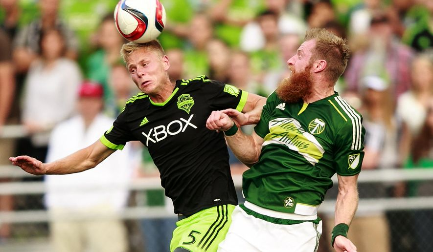 Seattle Sounders FC midfielder Andy Rose (5) heads the ball against Portland Timbers defender Nat Borchers (7) duringa U.S. Open Cup soccer match in Tukwila, Wash., Tuesday, June 16, 2015.  (Erika Schultz/The Seattle Times via AP) OUTS: SEATTLE OUT, USA TODAY OUT, MAGAZINES OUT, TELEVISION OUT, SALES OUT. MANDATORY CREDIT TO:  Erika Schultz / THE SEATTLE TIMES.