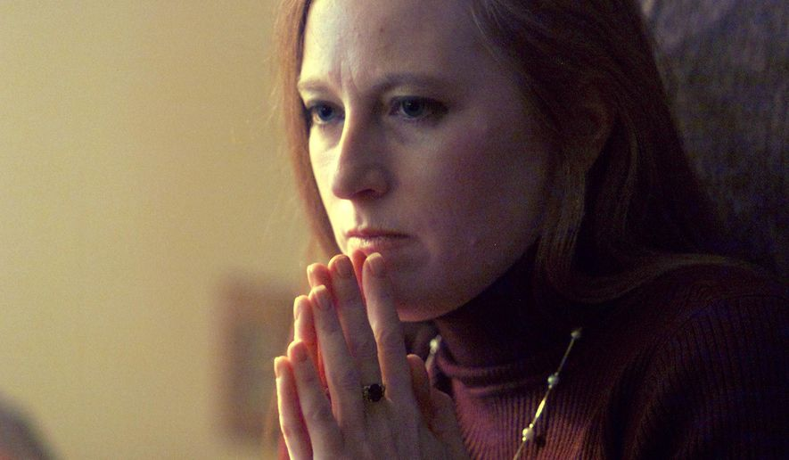 """In an Oct. 23, 2001 photo, Beth Carpenter, who is on house arrest at her parents home in Ledyard, Ct., ponders a question during an interview. Carpenter has lost her bid for a new trial in a murder-for-hire case that landed her in prison for life and was depicted in books and TV shows. A Rockville Superior Court judge on Tuesday, June 16, 2015, rejected arguments by Carpenter that her lawyers made mistakes at her trial, according to a court ruling obtained by The Associated Press on Wednesday. Carpenter, 51, was convicted of murder and conspiracy in 2002 for plotting with her lover and boss, Haiman Clein, to kill her brother-in-law, Anson """"Buzz"""" Clinton. (Michael Mcandrews/The Hartford Courant via AP) MANDATORY CREDIT"""