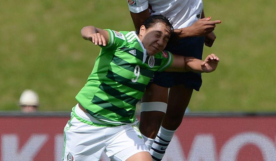 France's Wendie Renard (2) heads the ball over Mexico's Charlyn Corral during the first half of a FIFA Women's World Cup soccer match in Ottawa, Ontario, Canada, Wednesday, June 17, 2015. (Sean Kilpatrick/The Canadian Press via AP) MANDATORY CREDIT