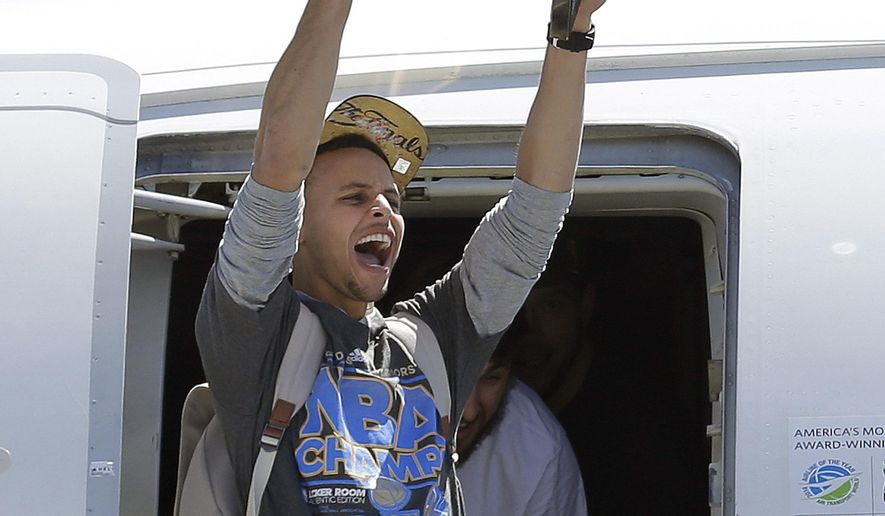 Golden State Warriors guard Stephen Curry yells as he lifts the Larry O'Brien championship trophy after the team landed in Oakland, Calif., Wednesday, June 17, 2015. The Warriors beat the Cleveland Cavaliers to win their first NBA championship since 1975. (AP Photo/Jeff Chiu)