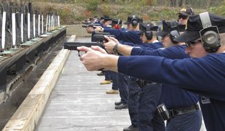 Connecticut state police recruits practice with their new .45-caliber Sig Sauer pistols during. (AP Photo/Dave Collins, File)