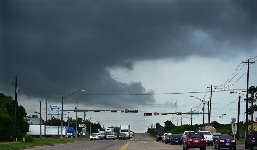 Ominous low-hanging clouds accompanied a thunderstorm from the outer bands of Tropical Storm Bill that was already reaching north Texas as this cell passed over East University Drive Tuesday, June 16, 2015, in Denton, Texas. (Al Key/The Denton Record-Chronicle via AP)